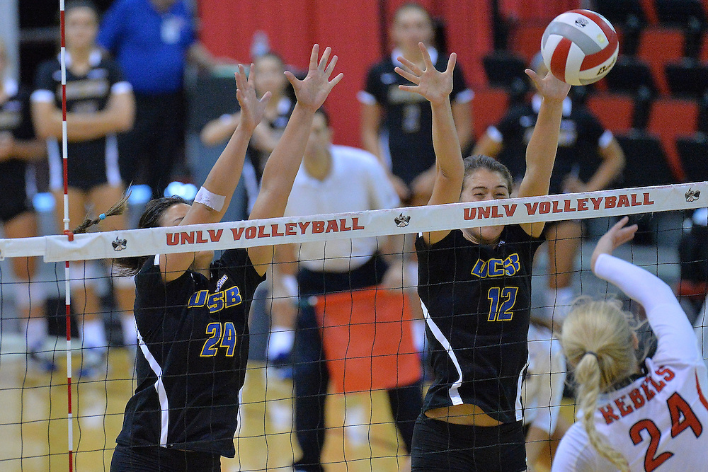 August 26, 2016; Las Vegas, Nev.; UC Santa Barbara outside hitter Chanel Hoffman (24) and UC Santa Barbara middle blocker Phoebe Grunt (12) go up for a block attempt during a match between the UNLV Lady Rebels and UC Santa Barbara Gauchos. UNLV defeated UCSB 3-0.
