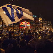Chicago Cubs fans celebrating outside Wrigley Field winning the World Series from the Cleveland Indians in 7 games.<br /> Photography by Jose More