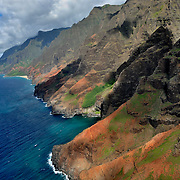 This photo was taken from the air on the western side of the island of Kauai off the Na Pali coast. Between the cliffs, the vegetation and the water, the colors are absolutely off the scale!