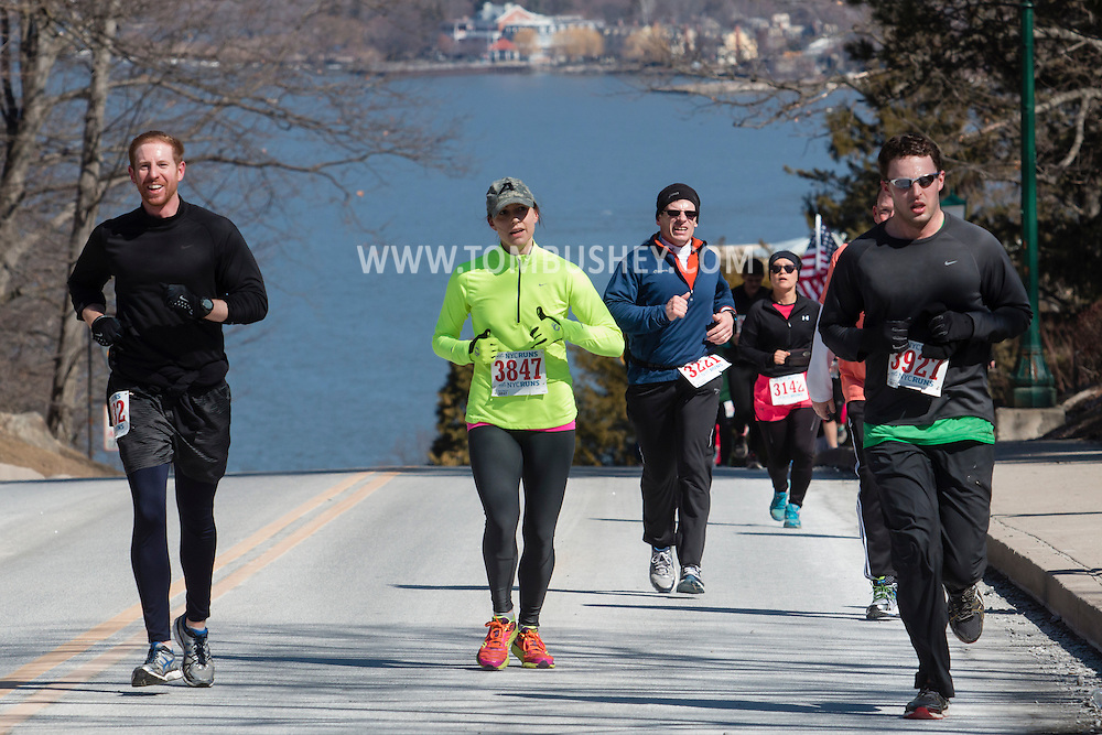 West Point, New York - Runners compete in the West Point Half-Marathon Fallen Comrades Run at the United States Military Academy on March 29, 2015. The Hudson River in in the background.