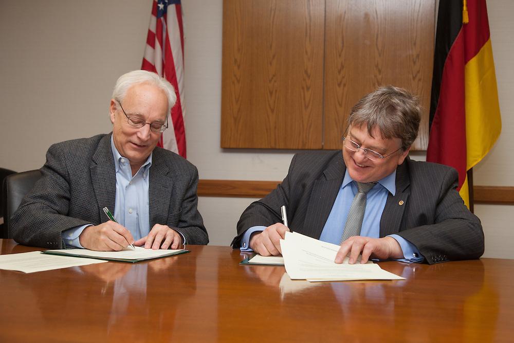 Dr. Hugh Sherman, Dean of OHIO College of Business, left and Professor Herbert Woratschek of University of Bayreuth sign  a Memoradum of Understanding.  Photo by Ohio University / Jonathan Adams