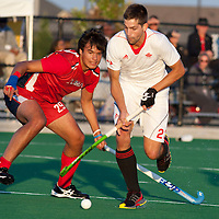 USA's Aki Kaeppeler (29) and Canada's Iain Smythe (23) go for the ball in the semi final of the Mens Pan American Cup at Cassie Campbell on Thursday. Canada defeated the Americans by a score of 1-0.