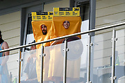 Spectators on a balcony dressed in a sandpaper costume during the ICC Cricket World Cup 2019 match between Afghanistan and Australia at the Bristol County Ground, Bristol, United Kingdom on 1 June 2019.