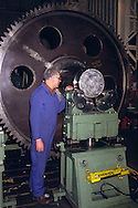 Engineer checking a large gear wheel during machining. Davy-Loewy later renamed Davy-McKee Sheffield.