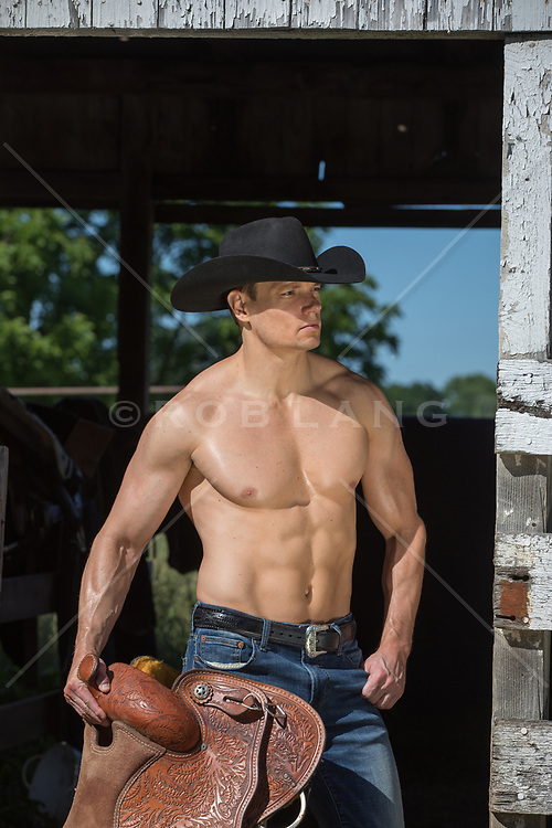 hot muscular cowboy on a ranch without a shirt