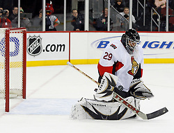 February 13, 2008; Newark, NJ, USA;  Ottawa Senators goalie Martin Gerber (29) makes a save during the second period at the Prudential Center in Newark, NJ.