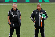 Nigel Pearson manager of Watford and Assistant Craig Shakespeare watch the warm up before the Premier League match at Vicarage Road, Watford. Picture date: 20th June 2020. Picture credit should read: Darren Staples/Sportimage