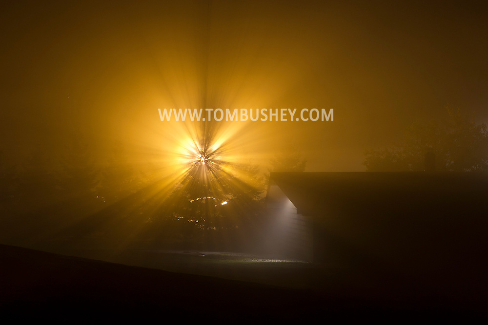 Middletown, New York - Lights and the moon shine through the fog on the night of Oct. 4, 2012