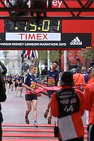 Matthew Merrick of Yorkshire & Humberside crosses the line to win the Boys U15 race in the Virgin Giving Mini London Marathon, Sunday 26th April 2015.<br /> <br /> Scott Heavey for Virgin Money London Marathon<br /> <br /> For more information please contact Penny Dain at pennyd@london-marathon.co.uk