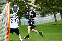 Coeur d'Alene High's Austin Brown elevates as he follows through on his successful shot on goal Friday against Gonzaga Prep during the North Idaho Lacrosse league championships.