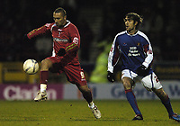 Photo: Jonathan Butler.<br />Swindon Town v Carlisle United. The FA Cup. 11/11/2006.<br />Swindon's two goal hero Christian Roberts controls the ball under pressure from Stephen Hindmarch.