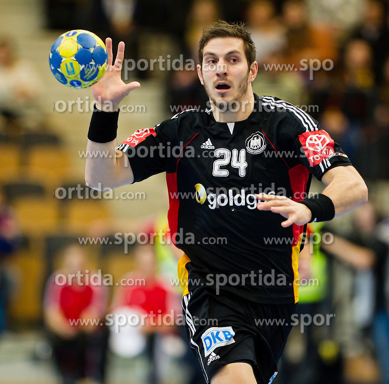 20.01.2011, Kristianstad Arena, SWE, IHF Handball Weltmeisterschaft 2011, Herren, Deutschland vs Tunesien, im Bild, // Haas 24 Germany // during the IHF 2011 World Men's Handball Championship match Germany vs Tunisia  at Kristianstad Arena, Sweden on 20/1/2011. EXPA Pictures © 2011, PhotoCredit: EXPA/ Skycam/ Henrik Johansson +++++ ATTENTION - OUT OF SWEDEN/SWE +++++