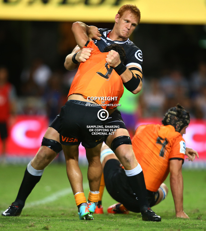 DURBAN, SOUTH AFRICA - MARCH 05:  Phillip van der Walt of the Cell C Sharks has hold of Martin Landajo of the Jaguares during the 2016 Super Rugby match between Cell C Sharks and Jaguares at Growthpoint Kings Park Stadium on March 05, 2016 in Durban, South Africa. (Photo by Steve Haag/Gallo Images)