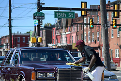 The local classic and American muscle car community gathers for a meet on a North Philadelphia, on Sunday.