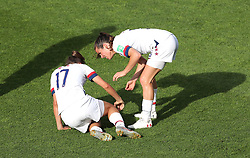 USA's Tobin Heath (left) after a tackle from Spain's Virginia Torrecilla (not pictured)
