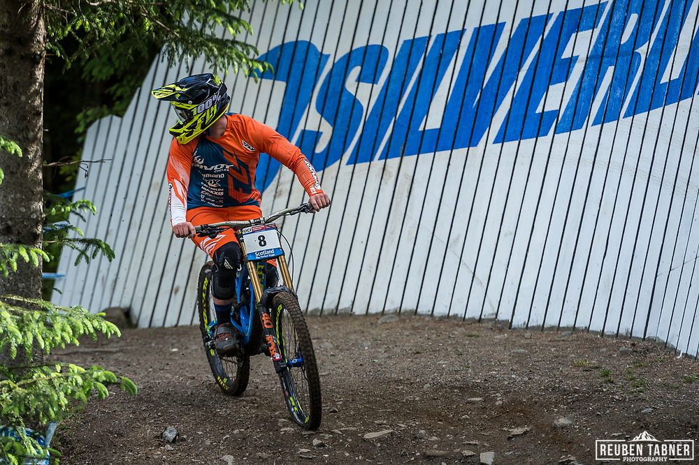 Rupert Chapman limps down with a front flat during his race run at the UCI Mountain Bike World Cup in Fort William.