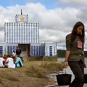 """Pro-Putin Nashi youths attend a lecture in front of a mock Parliament building (""""the White House"""") during a summer camp on Lake Seliger in Russia. The yearly camp, organised by the nationalistic group, trains youth in political activism."""