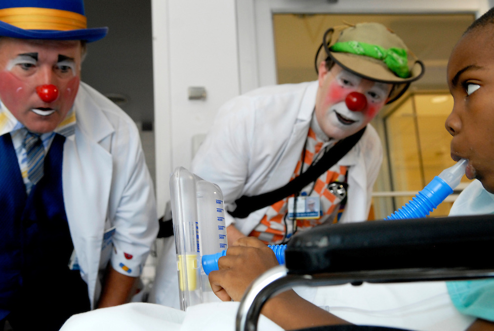(staff photo by Matt Roth)..Bill Boots, aka Dr. Boots, from Arbutus, and Greg May, a Columbia-based professional clown, entertain sick children at Johns Hopkins Hospital Wednesday July 19, 2006, as part of a program put on through the Big Apple Circus Clown Care program.