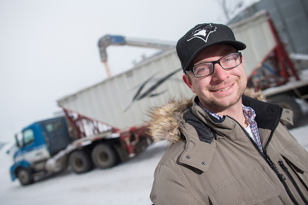 Corn producer Dave Park of Parkland Farms stands near his elevator at his farm in Sarnia, Ontario, February 4, 2014. While Park plans to keep approximately the same acreage of corn next season others have been forced to reduce their amount do to the nearly 40% drop in corn prices this winter.<br /> Farmers Forum/ Geoff Robins