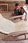 Teak furniture maker on the street. Yangon, Myanmar.