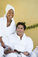 Portrait of couple in bathrobes at health spa