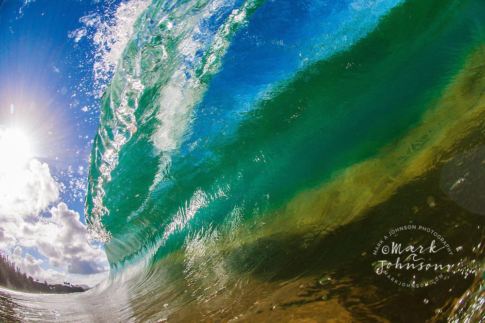 Shore break wave breaking on a Hawaiian Beach
