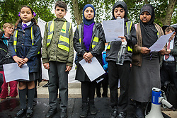 London, UK. 18 June, 2019. Children from the Hugh Myddelton Primary School Refugee Committee address a demonstration in Parliament Square to demand that the Government resettle 10,000 unaccompanied refugee children over 10 years. As part of Lord Dubs' 'Our Turn' campaign, councils around the UK have already pledged places for over 1,100 children if the Government should make a new resettlement commitment.