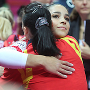 Alexandra Raisman, USA, hugs Catalina Ponor, Romania during the Women's Gymnastics Apparatus Beam final at North Greenwich Arena during the London 2012 Olympic games London, UK. 7th August 2012. Photo Tim Clayton