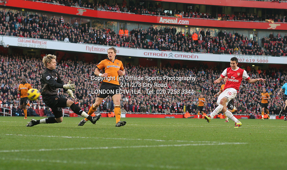 12/02/2011 FA Premier League. Arsenal v WolverhamptonWanderers.<br /> Robin Van Persie drives the ball past Wayne Hennessey to score the 2nd Arsenal goal.<br /> Photo: Mark Leech.