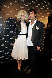 PORTIA FREEMAN and PETER DENTON at the Moet & Chandon Tribute to Cinema party held at the Big Sky Studios, Brewery Road, London N7 on 24th March 2009.