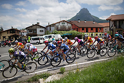 The peloton leans into a corner in the early kilometers of Stage 4 the Emakumeen Bira - a 58 km road race, between Etxarri Aranatz and San Miguel on May 20, 2017, in Basque Country, Spain. (Photo by Balint Hamvas/Velofocus)
