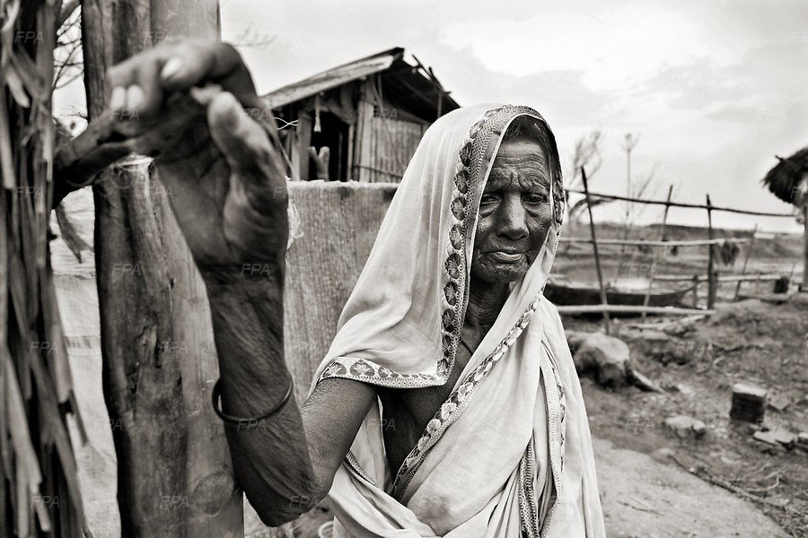 A widow who survived in the last couple of cyclones including Sidr and Aila while hit the coastal belt of Bangladesh.  Image © Mohammad Rakibul Hasan/Falcon Photo Agency