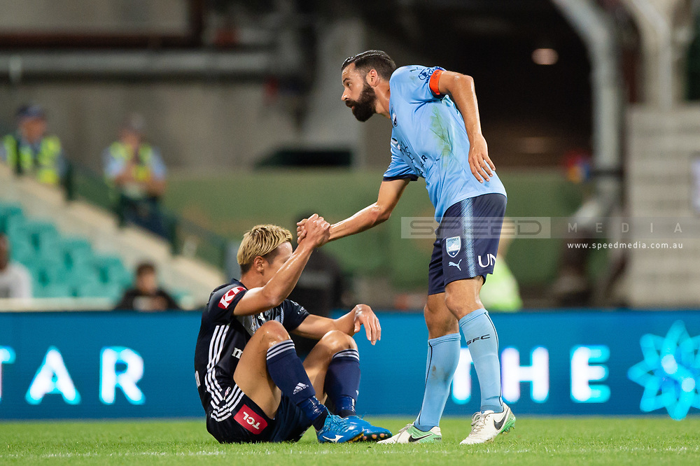 SYDNEY, AUSTRALIA - APRIL 06: Sydney FC forward Alex Brosque (14) helps Melbourne Victory midfielder Keisuke Honda (4) to get up at round 24 of the Hyundai A-League Soccer between Sydney FC and Melbourne Victory on April 06, 2019, at The Sydney Cricket Ground in Sydney, Australia. (Photo by Speed Media/Icon Sportswire)