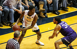 Feb 12, 2018; Morgantown, WV, USA; West Virginia Mountaineers forward Lamont West (15) looks to pass from the corner during the first half against the TCU Horned Frogs at WVU Coliseum. Mandatory Credit: Ben Queen-USA TODAY Sports