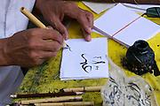 Uzbekistan, Samarqand.<br /> Registan ensemble. Ulugbek Medressa. Calligrapher.