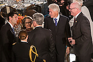 Representative and former Republican Vice Presidential candidate Paul Ryan (R-WI) talks with Secretary of State Hillary Clinton and former President Bill Clinton at the Inaugural Luncheon in Statuary Hall at the U.S. Capitol on Monday, January 21, 2013 in Washington, DC.