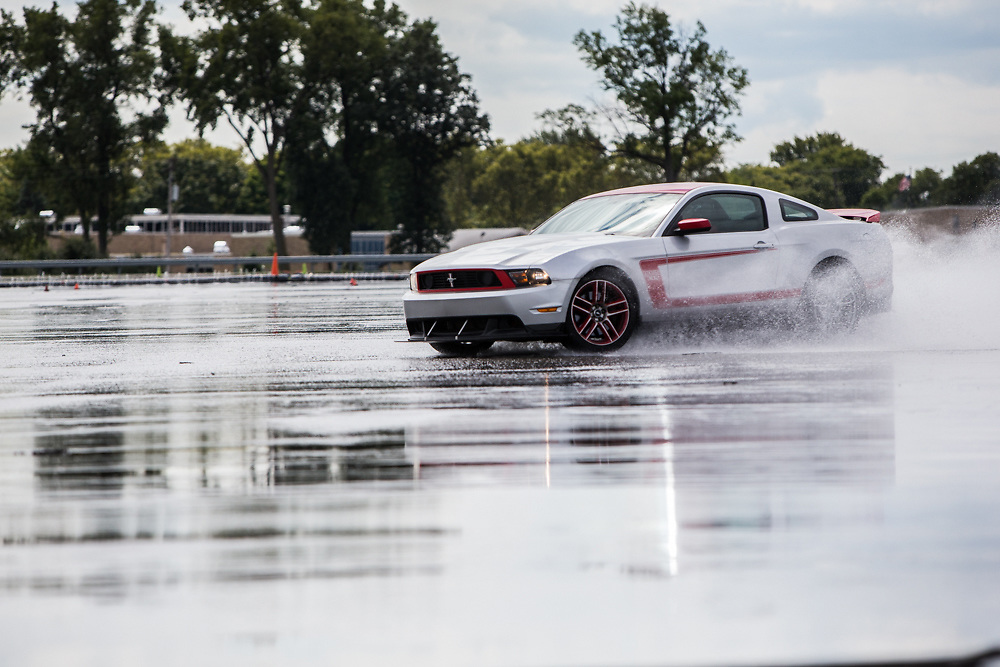 Ford Mustang demonstrating wet pad driving at Ford Proving Grounds at SAE event. Event Photography by KMS Photography