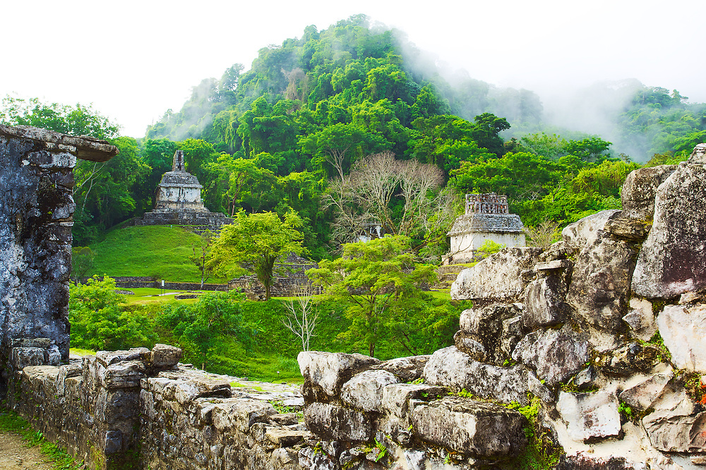 The morning fog lifts to reveal the jungle city of Palenque, México.