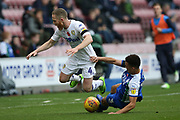 Leeds United midfielder Adam Forshaw (4) and Wigan Athletic defender Antonee Robinson (3) during the EFL Sky Bet Championship match between Wigan Athletic and Leeds United at the DW Stadium, Wigan, England on 4 November 2018.