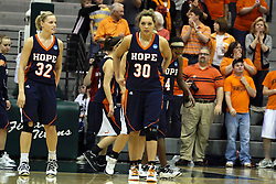 19 March 2010: Erika Bruinsma, Carrie Snikkers and Philana Greene take the floor. The Flying Dutch of Hope College defeat the Yellowjackets of the University of Rochester in the semi-final round of the Division 3 Women's Basketball Championship by a score of 86-75 at the Shirk Center at Illinois Wesleyan in Bloomington Illinois.