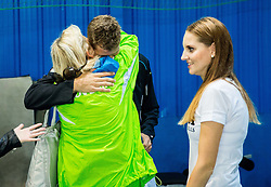 Blaz Rola of Slovenia with his mother and sister after winning during Davis Cup Slovenia vs Lithuania competition, on October 30, 2015 in Kranj, Slovenia. Photo by Vid Ponikvar / Sportida