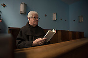 New York, NY, April 2, 2016. Franciscan Brother Paschal DeMattea, O.F.M. reading a book by St. Thomas Aquinas in New York City. 04/02/2016. Photo by George Goss/NYCity News Service.