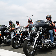 Riders on Harley Davidson participating in the annual Rolling Thunder motorcycle rally through downtown Washington DC on May 29, 2011. This shot was taken as the riders were leaving the staging area in the Pentagon's north parking lot, where thousands of bikes and riders had gathered.