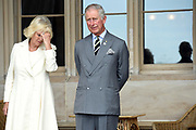 Britain's Prince Charles and his wife, Camilla the Duchess of Cornwall, listens to speeches during a reception at Government House in Sydney, Australia.