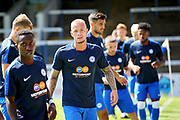 Peterborough United midfielder Joe Ward (15) leads the warm up before the Pre-Season Friendly match between Peterborough United and Bolton Wanderers at London Road, Peterborough, England on 28 July 2018. Picture by Nigel Cole.