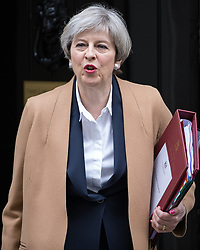 © Licensed to London News Pictures . 29/03/2017 . London , UK. The British Prime Minister THERESA MAY leaves 10 Downing Street in Westminster, for Prime Minster's Questions and to formally trigger Article 50 . Today (29th March 2017) the British Government will trigger Article 50 of the Lisbon Treaty and commence Britain's withdrawal from the European Union . Photo credit : Joel Goodman/LNP