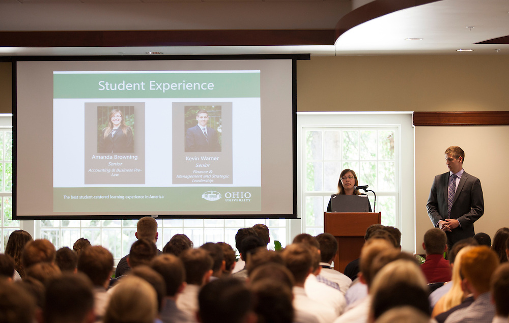 Amanda Browning, a senior accounting and business pre-law student, speaks to freshman in the College of Business while Kevin Warner, a senior finance and management and strategic leadership student stands by her side, in Nelson Commons on Saturday, August 22, 2015. Two College of Business seniors gave advice to the new students. Photo by Kaitlin Owens