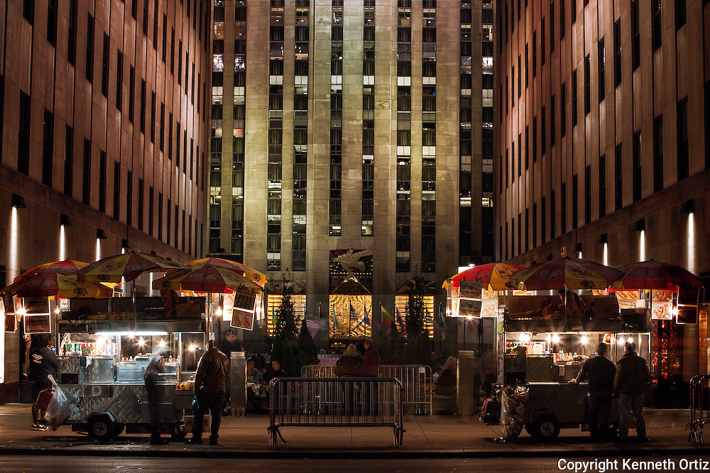 A shot of food venders parked in front of Rockefeller Plaza on 5th Avenue in New York City.