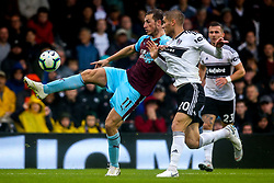 Chris Wood of Burnley takes on Maxime Le Marchand of Fulham - Mandatory by-line: Robbie Stephenson/JMP - 26/08/2018 - FOOTBALL - Craven Cottage - Fulham, England - Fulham v Burnley - Premier League