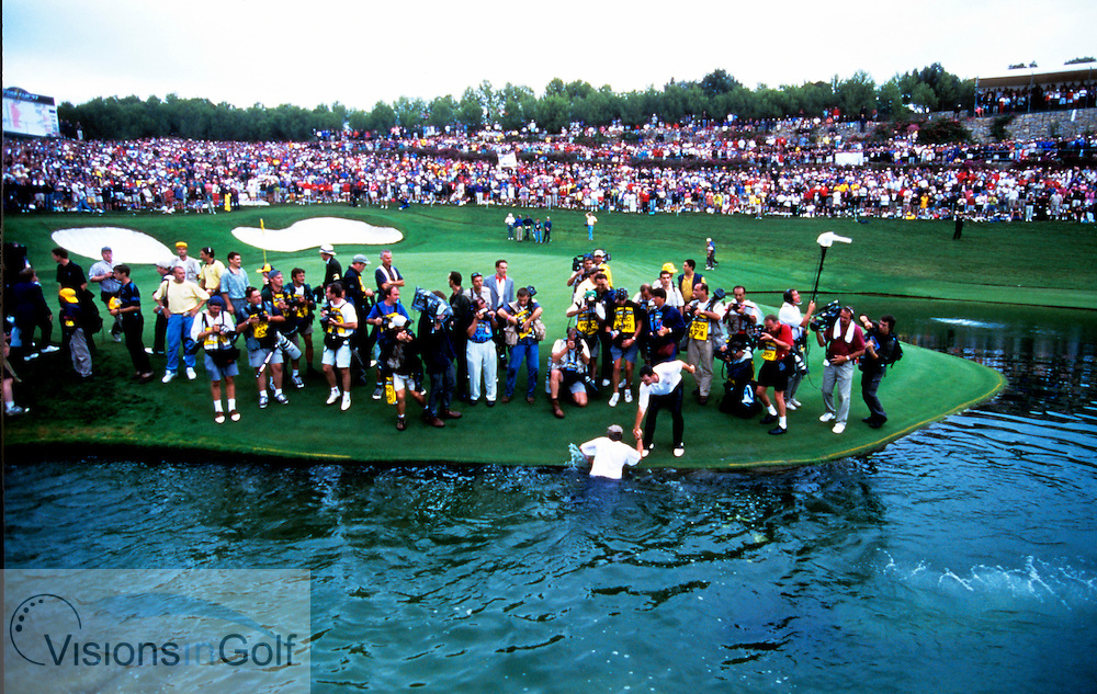caddys in the water in celebration of winning <br /> Ryder Cup matches 1997, Valderrama, Spain. <br /> Picture credit:  Mark Newcombe / visionsingolf.com